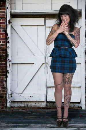 Beautiful tattooed young woman looking far away Stock Photo - 16717625