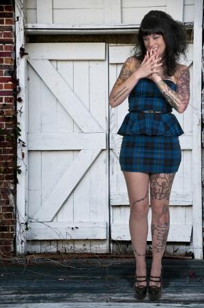 tat: Beautiful tattooed young woman looking far away