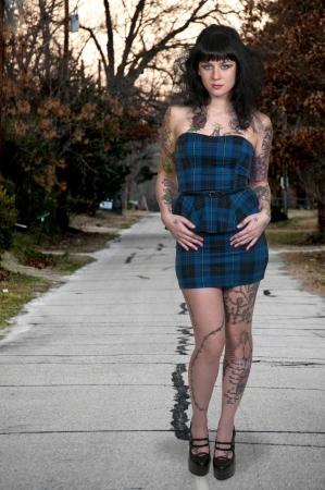 Beautiful tattooed young woman looking far away Stock Photo - 16717438
