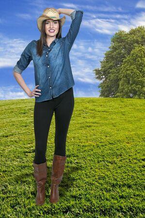 Beautiful young country girl woman wearing a stylish cowboy hat Stock Photo - 16717435