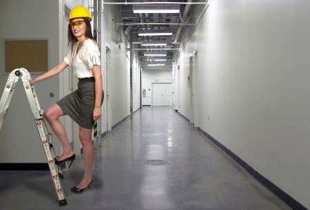 Female Construction Worker wearing a hard hat and safety glasses photo