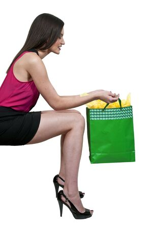 Beautiful young woman on a shopping spree Stock Photo - 16717658