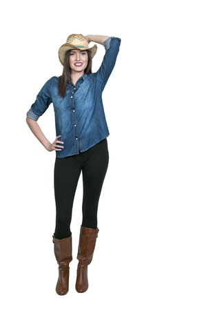 Beautiful young country girl woman wearing a stylish cowboy hat Stock Photo - 16717687