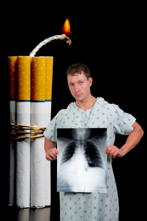 Male patient with several cigarettes bound together like sticks of dynamite