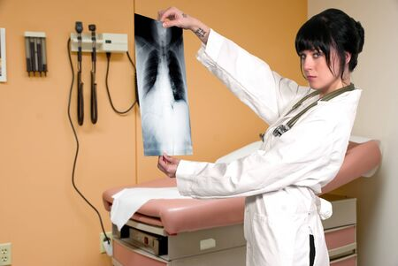 A beautiful female radiologist examining an x-ray photo