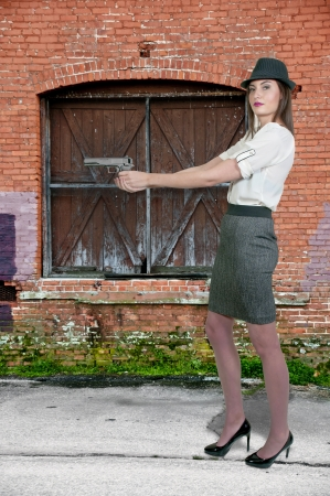 Beautiful police detective woman on the job with a gun Stock Photo - 16717421