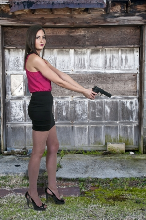 law enforcer: Beautiful police detective woman on the job with a gun