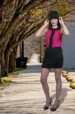 Beautiful young woman wearing a cloche hat photo