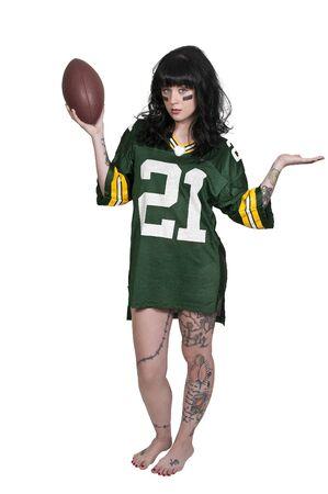 tatt:  beautiful young woman playing a game of football