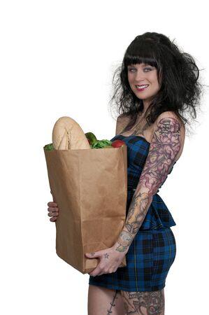tatt: Beautiful young woman with a brown paper shopping bag