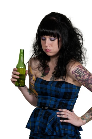 Beautiful woman about to vomit her beer photo