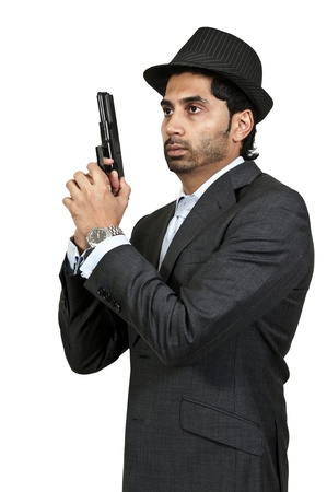 private i: Male police private detective man on the job with a gun Stock Photo