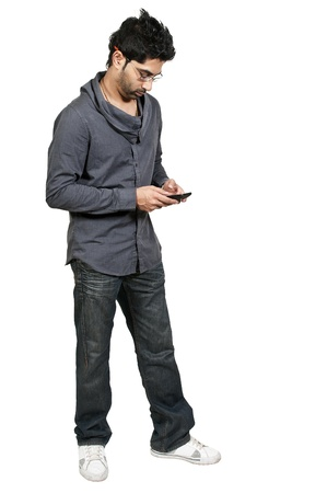 Young man using a cell phone for texting Stock Photo - 17425589