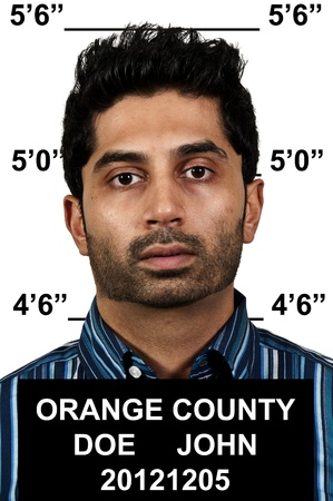 Mugshot of a handsome young man criminal Stock Photo