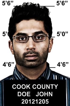 Mugshot of a handsome young man criminal Standard-Bild