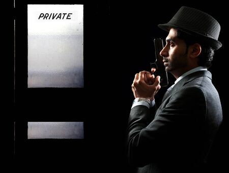 Male police private detective man on the job with a gun Stock Photo - 17425881