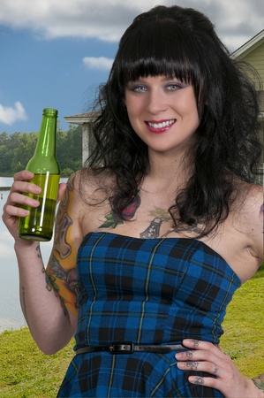 tatt: An woman drinking the adult beverage known as beer Stock Photo