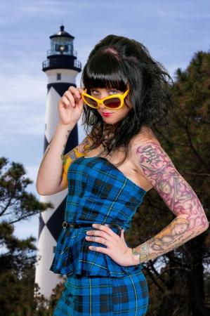 tatt: Beautiful woman wearing a pair of sunglasses