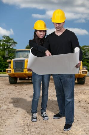Man and Woman Construction Workers on a job site photo