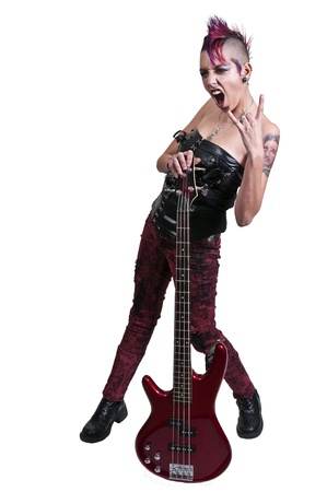 Beautiful woman punk rocker with an electric bass guitar photo