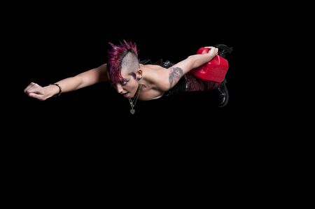 Beautiful punk rock woman flying with a gas can Stock Photo - 17425577