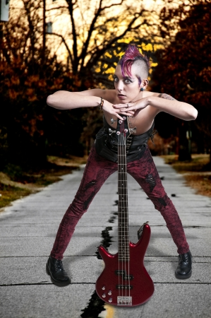 tatt: Beautiful woman punk rocker with an electric bass guitar