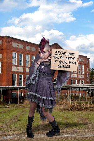 tatt: A beautiful young woman holding up an inspirational sign
