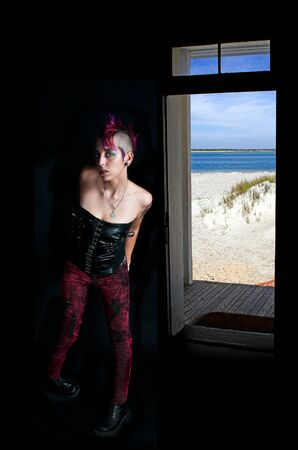 Beautiful young punk rock alternative lifestyle woman at the beach photo