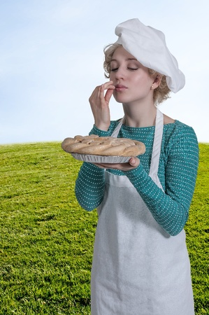 Beautiful woman chef holding a freshly baked pie photo