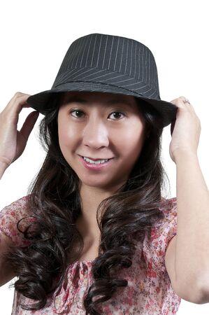 Beautiful asian woman in a fedora hat photo