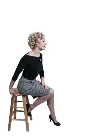 stool: Beautiful young woman stiing on a stool