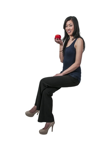 winesap apple: Beautiful young Asian woman with a whole red delicious apple  Stock Photo