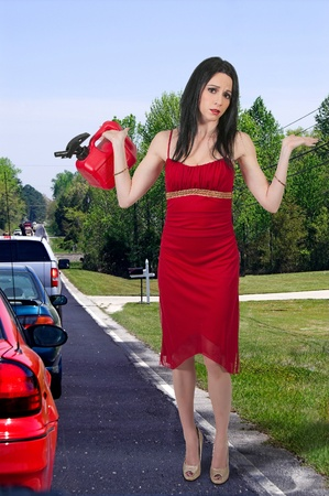 Beautiful woman with gas can out of gas