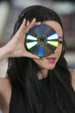 bluray: Beautiful woman holding a CD or Blue Ray DVD