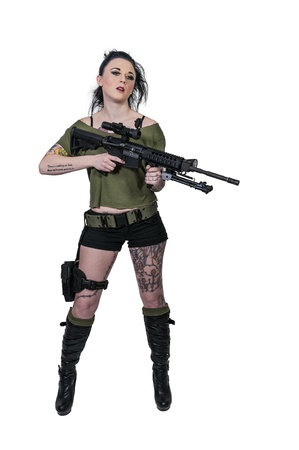 assault forces: Beautiful young woman holding an automatic assault rifle
