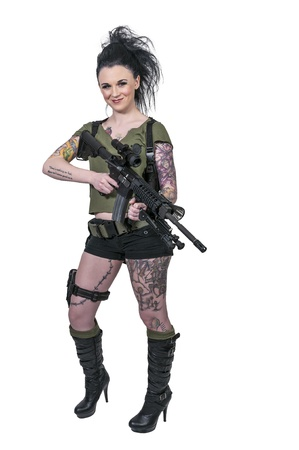 sexy army girl: Beautiful young woman holding an automatic assault rifle