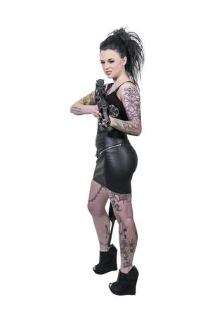 tatt: Beautiful young woman holding an automatic assault rifle