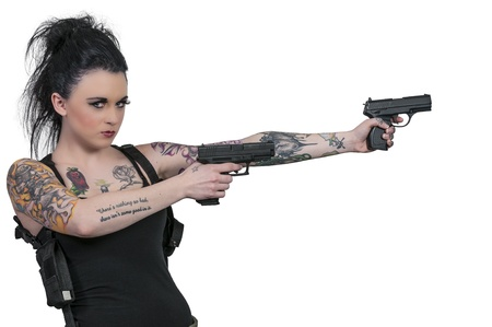 Beautiful young woman shooting things with pistols photo