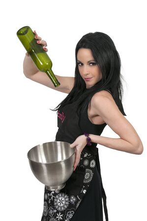 Beautiful woman chef cooking with a bottle of wine photo