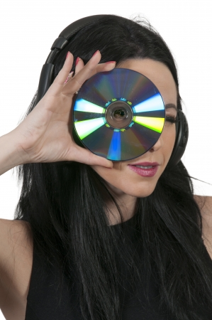 Beautiful woman holding a CD or Blue Ray DVD