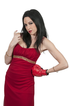 come hither: A beautiful young woman wearing a pair of boxing gloves