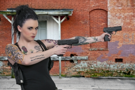 sexy police: Beautiful young woman shooting things with pistols