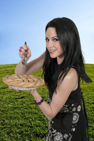 Beautiful woman chef holding a freshly baked pie Stock Photo - 18200064