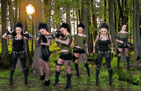 sexy army: Beautiful young women holding an automatic assault rifles