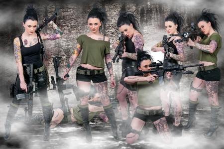 Beautiful young women holding an automatic assault rifles photo