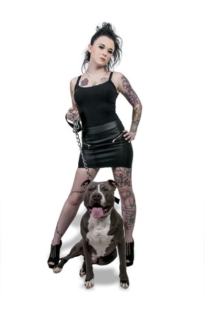 Beautiful young woman with her pit bull dog photo