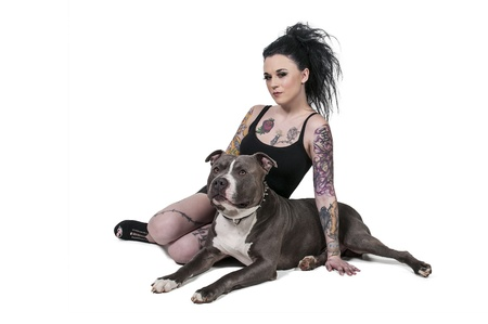 tatt: Beautiful young woman with her pit bull dog Stock Photo