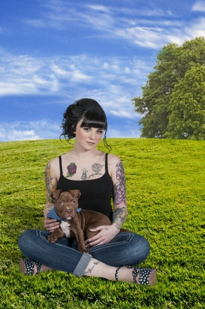 tatt: Beautiful young woman with her pit bull puppy