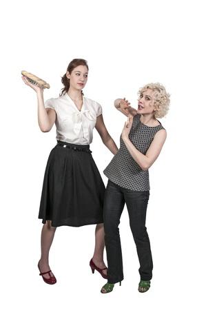 Beautiful woman having a friendly pie fight photo