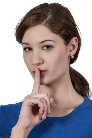 noiseless: A woman saying be quiet by saying shhh Stock Photo